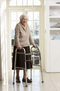 9911715-Elderly-Senior-Woman-Using-Walking-Frame-Stock-Photo-seniors-disabled-walking