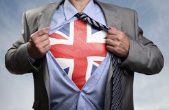 superhero-businessman-revealing-british-flag-classic-superman-pose-tearing-his-shirt-open-to-reveal-t-shirt-union-jack-68347921